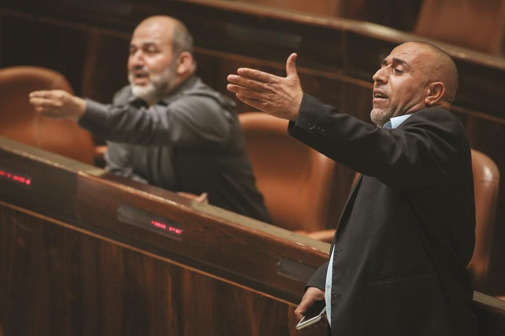 Arab member of Knesset of the Joint List party Taleb Abu Arar (R) during a Knesset session. (Hadas Parush/Flash90)