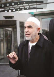 Sheikh Raed Salah, leader of the northern branch of the Islamic Movement in Israel, speaks to the press following the Security Cabinet's decision to outlaw the movement, on Tuesday. (Basel Awidat/Flash90)