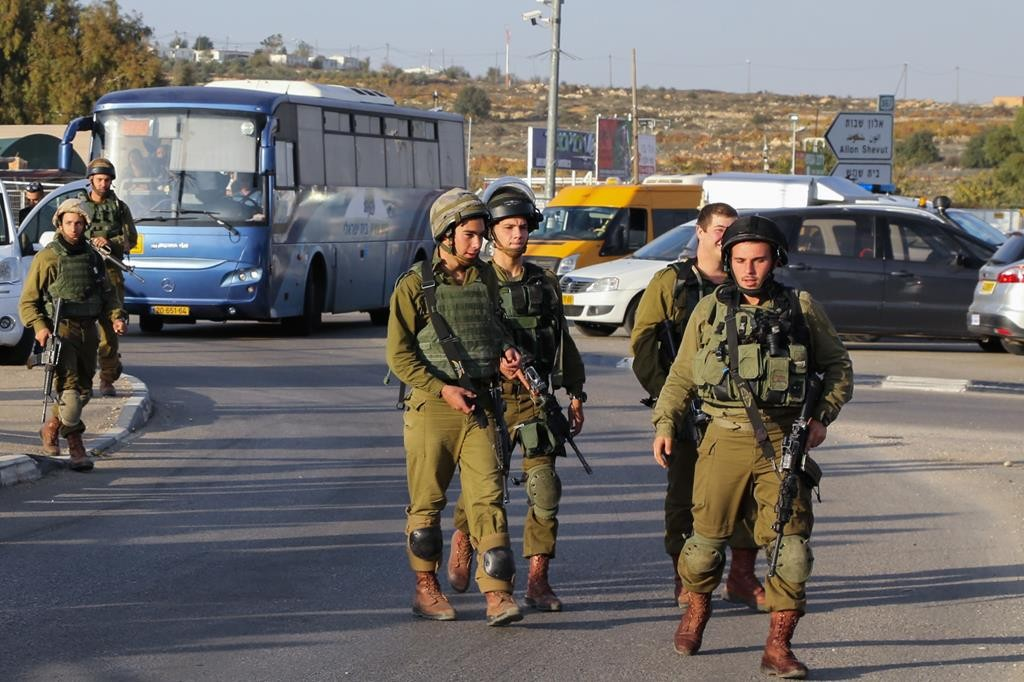 Israeli soldiers at the site of a deadly terror attack near the Gush Etzion junction on Sunday. (Gershon Elinson/Flash90)