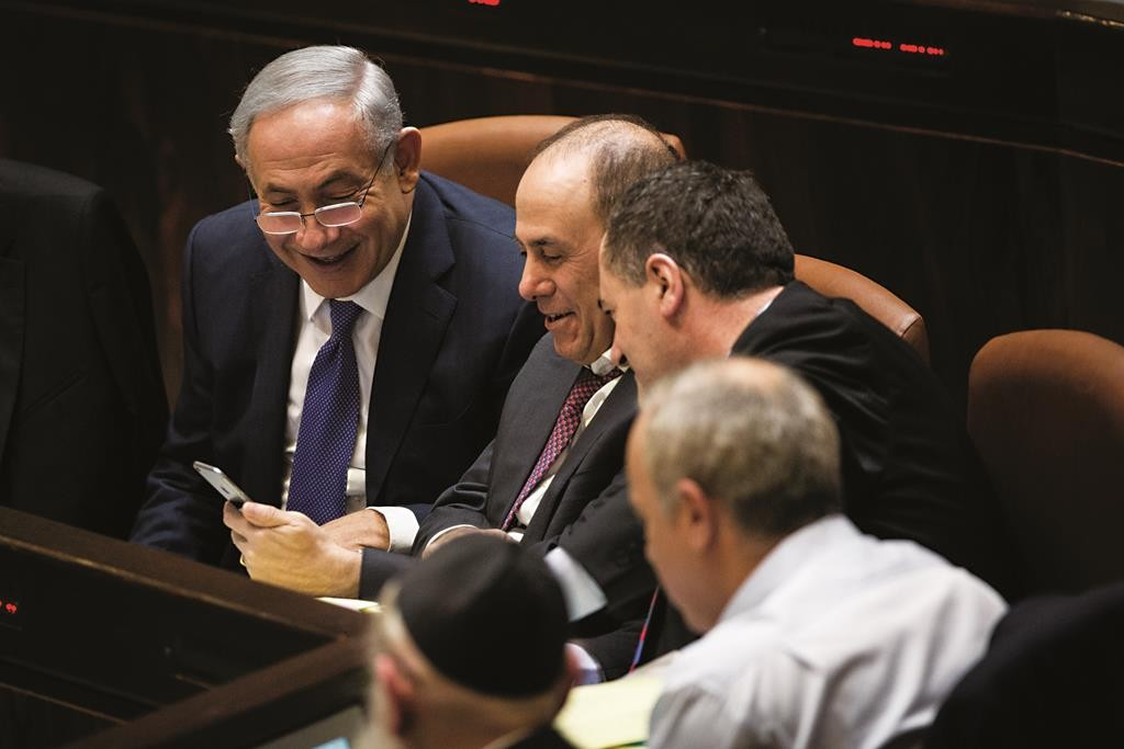 Prime Minister Binyamin Netanyahu with Silvan Shalom and other cabinet buddies during the long night of the budget session. (Hadas Parush/Flash90)