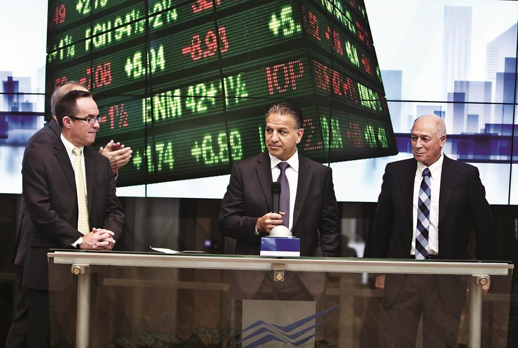 Robert J. Coury, chairman and chief executive officer of Mylan (C), stands next to Amnon Neubach, the chairman of Tel Aviv Stock Exchange (R) during a bell ringing ceremony at the Tel Aviv Stock Exchange, Wednesday. (Reuters/Nir Elias)