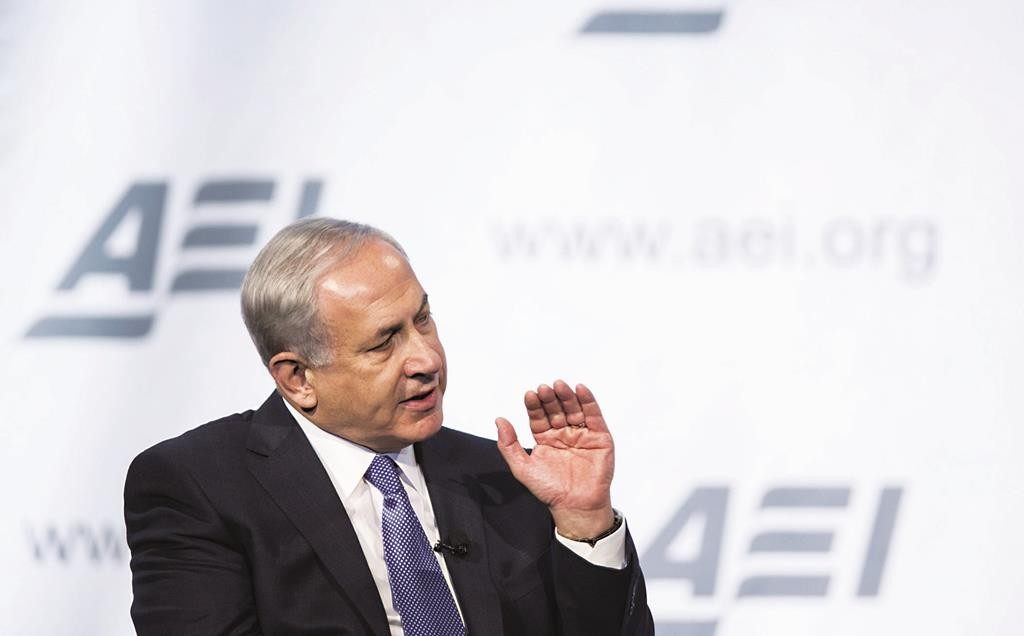 Israeli Prime Minister Binyamin Netanyahu speaks at the American Enterprise Institute annual dinner in Washington on Monday night. (REUTERS/Joshua Roberts)