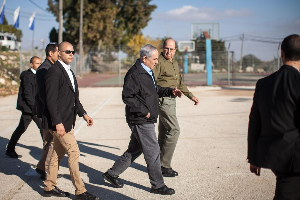 Prime Minister Binyamin Netanyahu (2nd L) and Minister of Defense Moshe Yaalon (L)arriving in Gush Etzion on Monday. (Emil Salman/Haaretz)