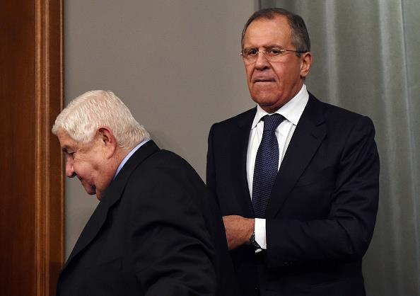 Syrian Foreign Minister Walid Muallem (L) and his Russian counterpart Sergei Lavrov leave at the end of a press conference in Moscow last Friday. (VASILY MAXIMOV/AFP/Getty Images)
