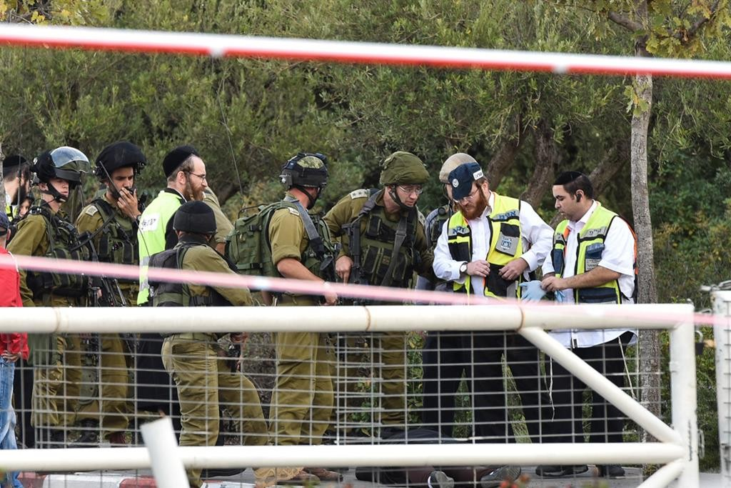 Israeli security and rescue forces at the scene of a stabbing at the entrance to Beitar Illit, on Sunday. (Eli Segal/Flash90)