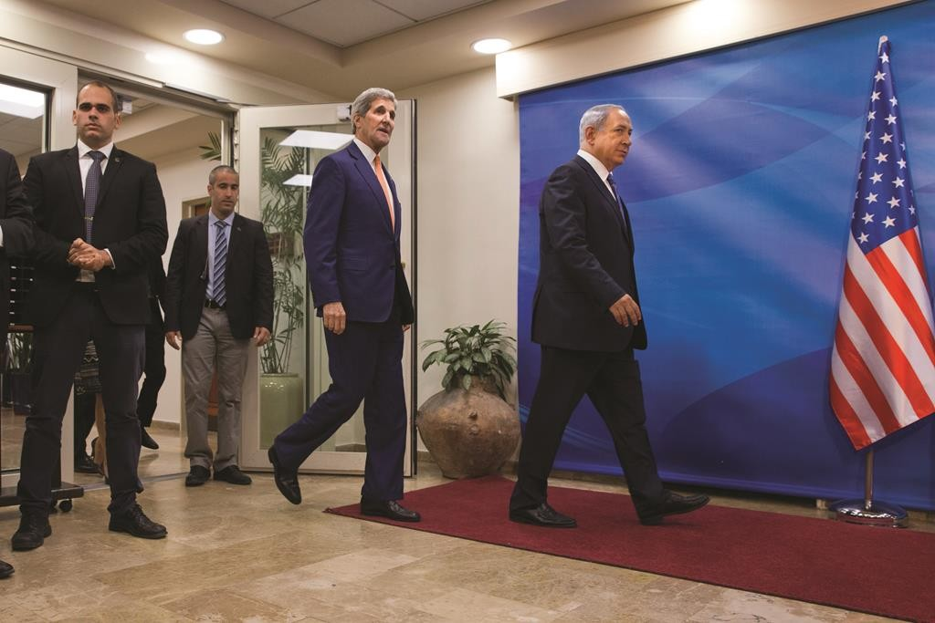 Israeli Prime Minister Benjamin Netanyahu, right, and U.S. Secretary of State John Kerry, arrive to speak to the media at the Prime Minister's Office in Jerusalem Tuesday, Nov. 24, 2015. (AP Photo/Jacquelyn Martin, Pool)