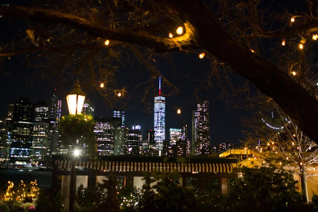 One World Trade Center spire is lit up in blue, white and red, the French colors, in honor of dozens killed in the Paris attacks. (AP Photo/Kevin Hagen)