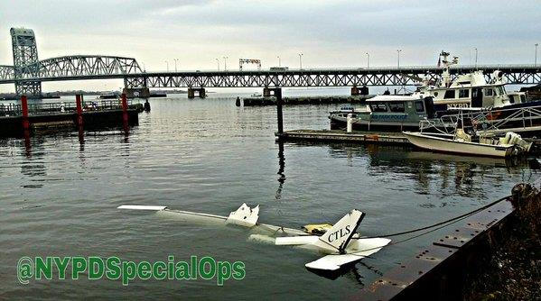 Police pull a small plane on Thursday from the waters of the Atlantic Ocean off Queens. (NYPD Special Ops)