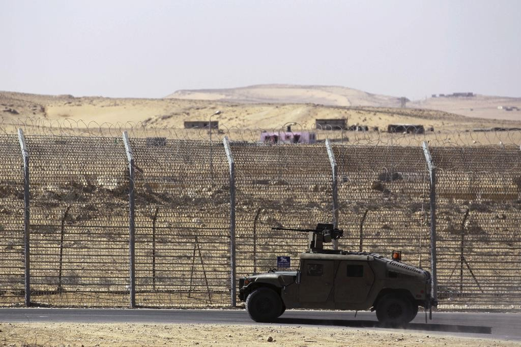 An armored Israeli military vehicle drives along the border of the Sinai peninsula, near the Nitzana crossing in this picture, taken January 30, 2014. (Reuters/Amir Cohen/Files)