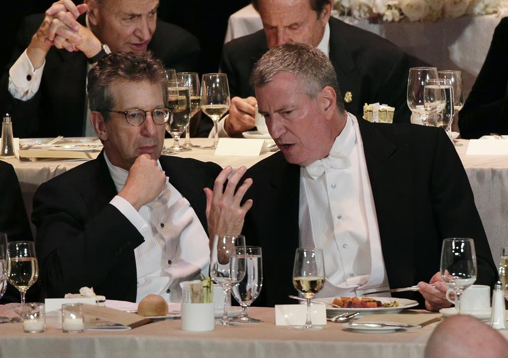 Mayor Bill de Blasio, right, on Tuesday night at the Alfred Smith Foundation dinner. (AP Photo/Julie Jacobson)
