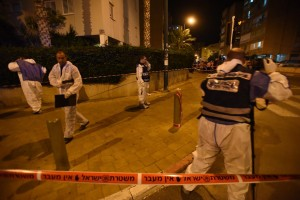 Israeli forensic police officers at the scene of a terror attack in Netanya Monday night. (Gili Yaari/Flash90)