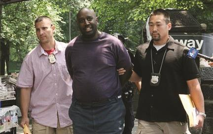 Darius McCollum during a 2008 arrest for impersonating an MTA worker. (AP Photo)