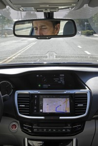 Reporter Matt O'Brien glances at the map on the dashboard of a Honda Accord that is hooked up to Matt's iPhone through the Apple CarPlay app as he makes his way to the nearest coffee shop in Hayward, Calif. (Laura A. Oda/Bay Area News Group/TNS)