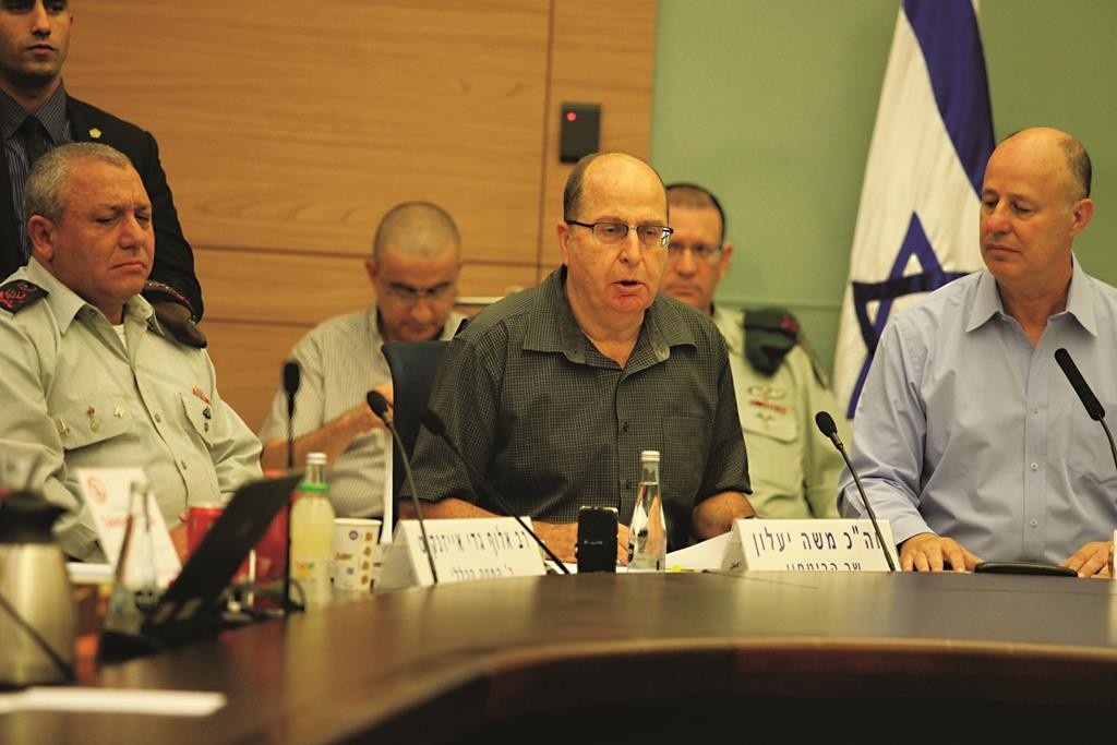 Defense Minister Moshe Yaalon (C), chairman of the Foreign Affairs and Defense Committee Tzachi Hanegbi (R), and IDF Chief of Staff Gadi Eizenkott at a Foreign Affairs and Defense Committee meeting at the Knesset on Tuesday. (Issac Harari/Flash90)