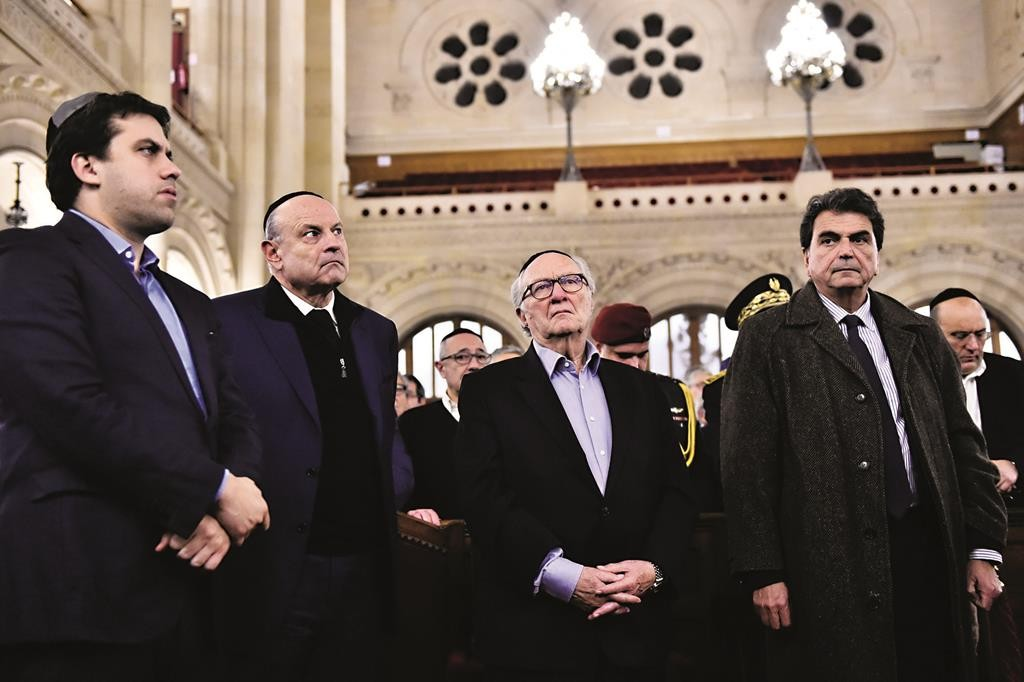 French right-wing party UMP national delegate Pierre Lelouche (R), Council of French Jewish Institutions president Roger Cukierman (2nd R), and French junior minister for Parliamentary Relations Jean-Marie Le Guen (2nd L) attend a ceremony for the victims of a series of deadly attacks, at the Grande Synagogue de la Victoire in Paris on November 15. (LOIC VENANCE/AFP/Getty Images)