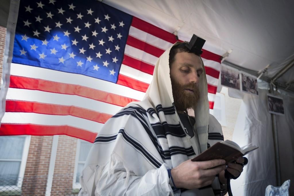 A man davening in a tent put up to host a minyan in Staten Island before running in the New York City Marathon.  (Reuters/Carlo Allegri)