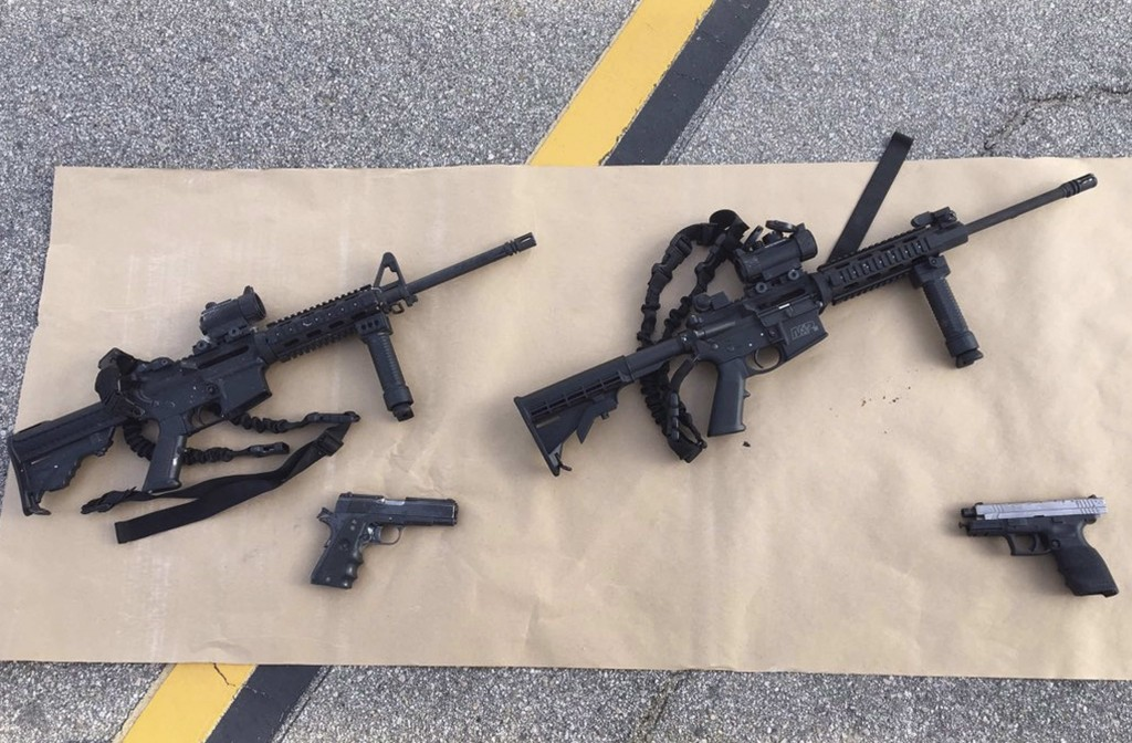 Weapons confiscated from last Wednesday's attack in San Bernardino, California are shown in this San Bernardino County Sheriff Department handout photo from their Twitter account released to Reuters December 3, 2015. Federal authorities are preparing criminal charges against Enrique Marquez -- a friend and former neighbor of Syed Rizwan Farook and Tashfeen Malik -- who investigators say supplied guns to the married couple who killed 14 people at a holiday party in San Bernardino, California, this month, two government sources said December 17, 2015. REUTERS/San Bernardino County Sheriffs Department/Handout ATTENTION EDITORS - THIS IMAGE HAS BEEN SUPPLIED BY A THIRD PARTY. IT IS DISTRIBUTED, EXACTLY AS RECEIVED BY REUTERS, AS A SERVICE TO CLIENTS. FOR EDITORIAL USE ONLY. NOT FOR SALE FOR MARKETING OR ADVERTISING CAMPAIGNS - RTX1X439