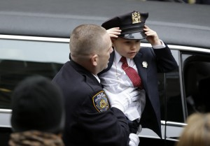Ryan Lemm, 4, son of Joseph Lemm, arrives for his father's funeral Wednesday. (AP Photo/Seth Wenig)