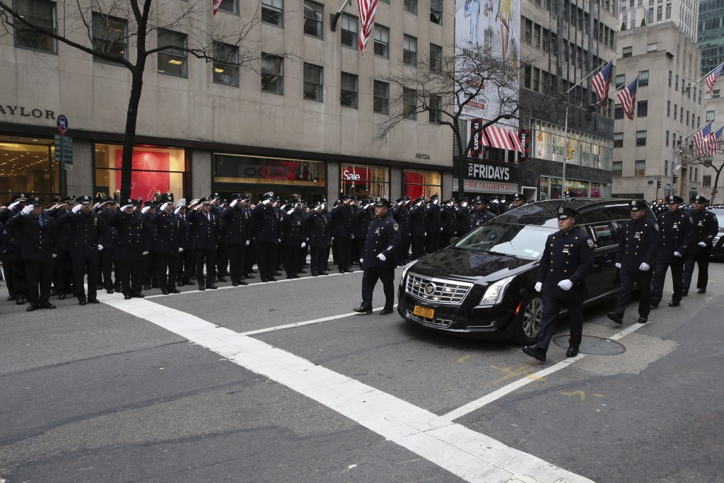 The funeral procession for Joseph Lemm makes its way down Fifth Avenue in New York on Wednesday. (AP Photo/Mary Altaffer)