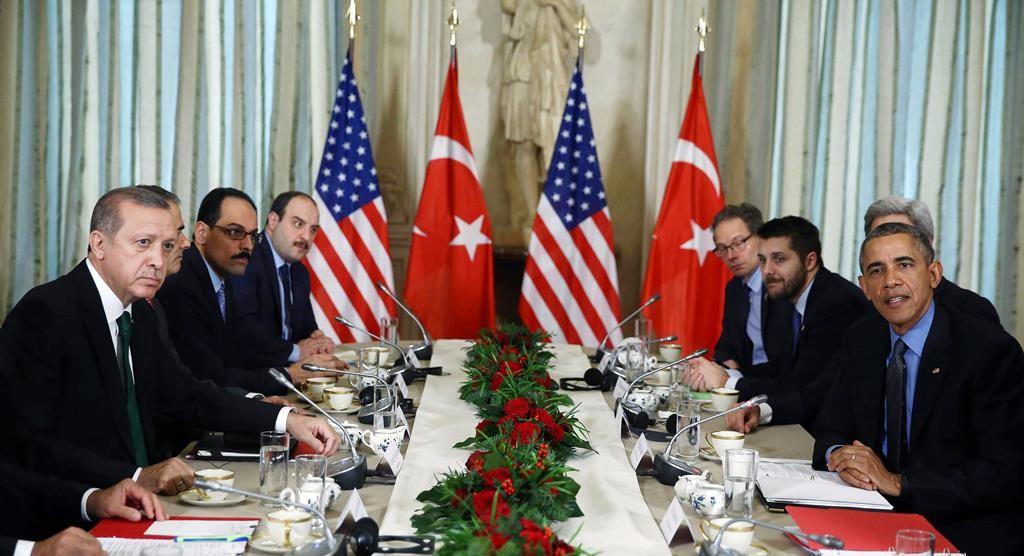 President Barack Obama (R) speaks before a bilateral meeting with Turkish President Recep Tayyip Erdogan (L) in Paris, France, Tuesday. (AP Photo/Yasin Bulbul, Presidential Press Service, Pool)