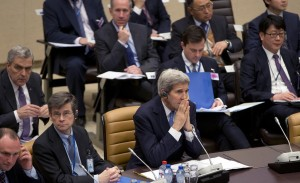 Secretary of State John Kerry (C) waits for the start of a round-table meeting of Resolute Support at NATO headquarters in Brussels on Tuesday. Kerry and other NATO foreign ministers met to discuss Russia and the beefing up of the alliance's southern defenses. (AP Photo/Virginia Mayo)