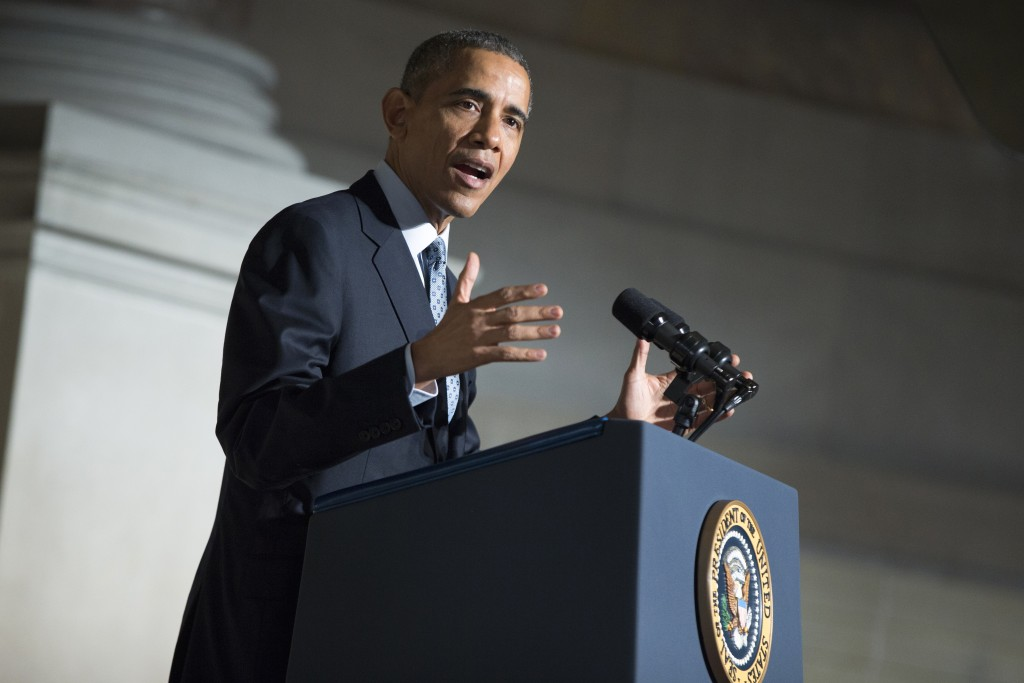 President Barack Obama speaks during a naturalization ceremony at the National Archives in Washington on Tuesday. (AP Photo/Evan Vucci)