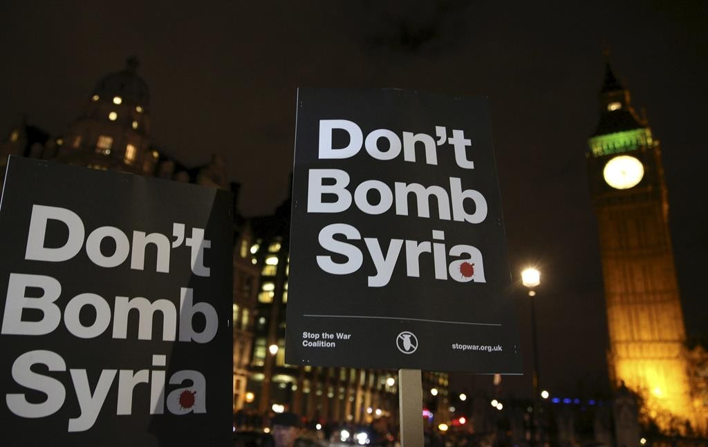 Anti-war protesters demonstrate against proposals to bomb Syria outside the Houses of Parliament in London, Britain Tuesday.  (Reuters/Neil Hall)