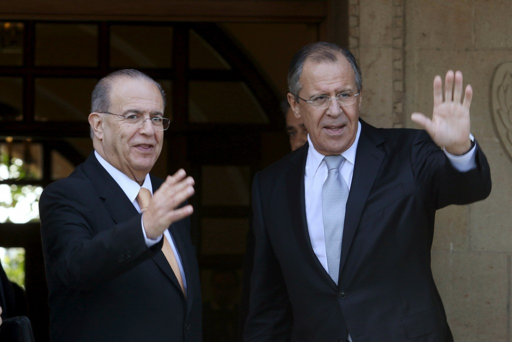 Russian Foreign Minister Sergei Lavrov and Cypriot Foreign Minister Ioannis Kasoulides waves to media at the Presidential Palace in Nicosia, Cyprus December 2, 2015. REUTERS/Yiannis Kourtoglou
