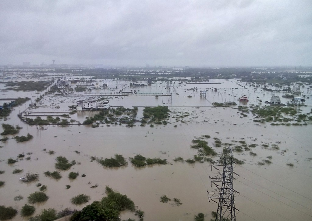 Flooded areas are pictured on the outskirts of Chennai, India, December 2, 2015. The heaviest rainfall in over a century has caused massive flooding across the southern Indian state of Tamil Nadu, driving thousands from their homes, shutting auto factories and paralysing the airport in the state capital Chennai. REUTERS/Stringer EDITORIAL USE ONLY. NO RESALES. NO ARCHIVE