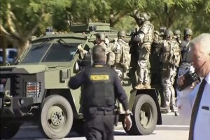 Police SWAT team members ride on a armored vehicle outside the Inland Regional Center in San Bernardino, California in this still image taken from video December 2, 2015. At least 20 people were reported injured in an active shooter situation, according to news reports. REUTERS/NBCLA.com/Handout via Reuters NO SALES. FOR EDITORIAL USE ONLY. NOT FOR SALE FOR MARKETING OR ADVERTISING CAMPAIGNS. THIS IMAGE HAS BEEN SUPPLIED BY A THIRD PARTY. IT IS DISTRIBUTED, EXACTLY AS RECEIVED BY REUTERS, AS A SERVICE TO CLIENTS NO RESALES. NO ARCHIVE TPX IMAGES OF THE DAY