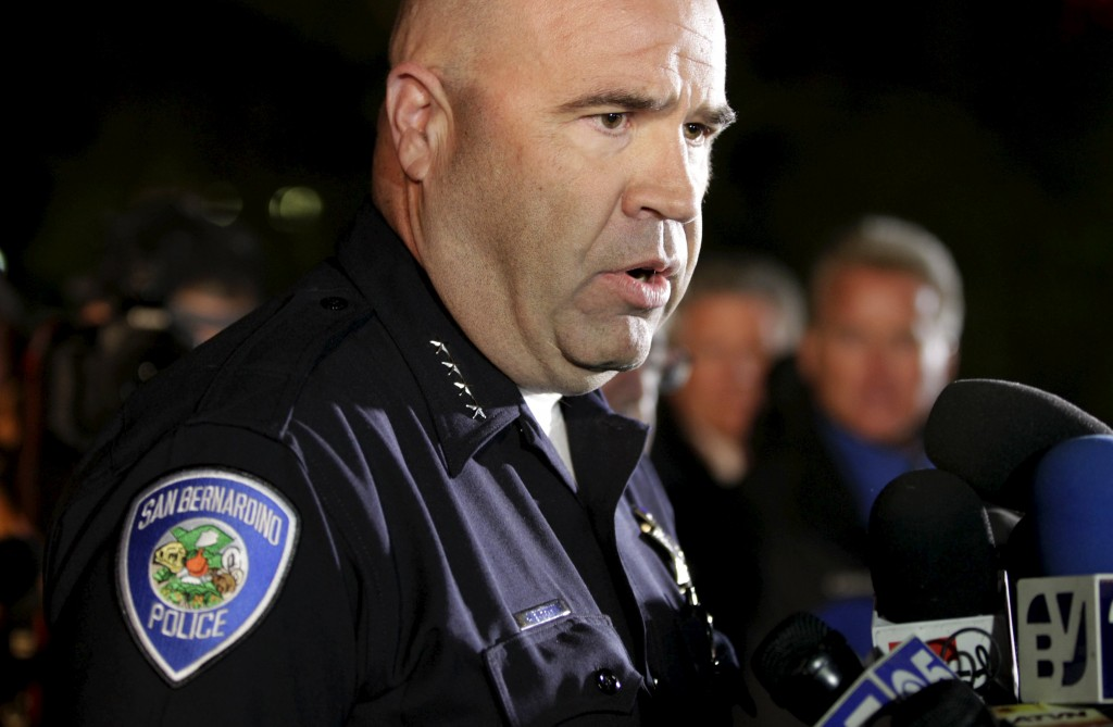San Bernardino Police Chief Jarrod Burguan (C) speaks at a news conferenece, informing the media, that the couple Syed Rizwan Farook, 28, and Tashfeen Malik, 27, were responsible for the shooting rampage at the Inland Regional Center, in San Bernardino, California December 2, 2015. Farook and Malik were later killed in a shootout with police in San Bernardino. REUTERS/Alex Gallardo TPX IMAGES OF THE DAY