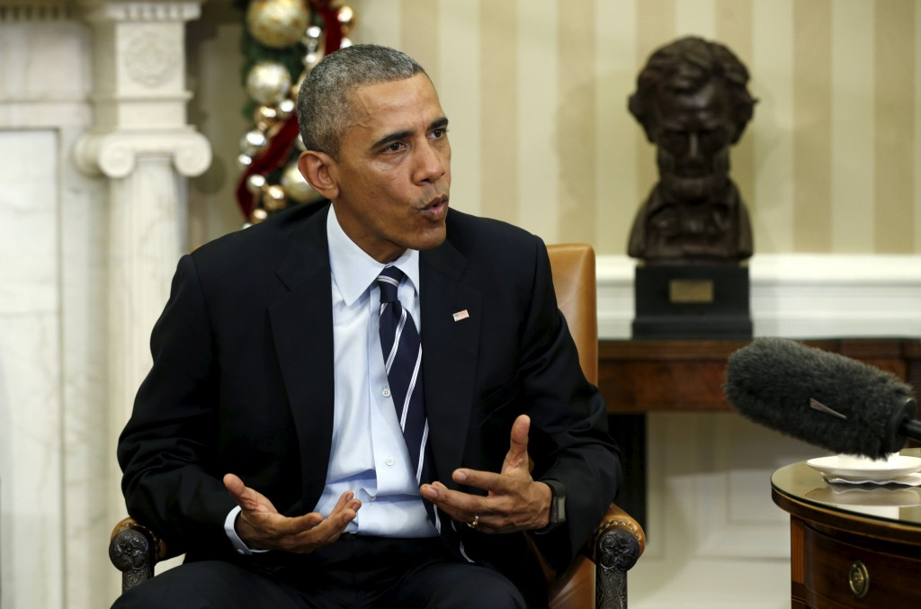 President Barack Obama speaks about the shootings in San Bernardino, California, during a meeting with his national security team in the Oval Office Thursday. (Reuters/Kevin Lamarque)