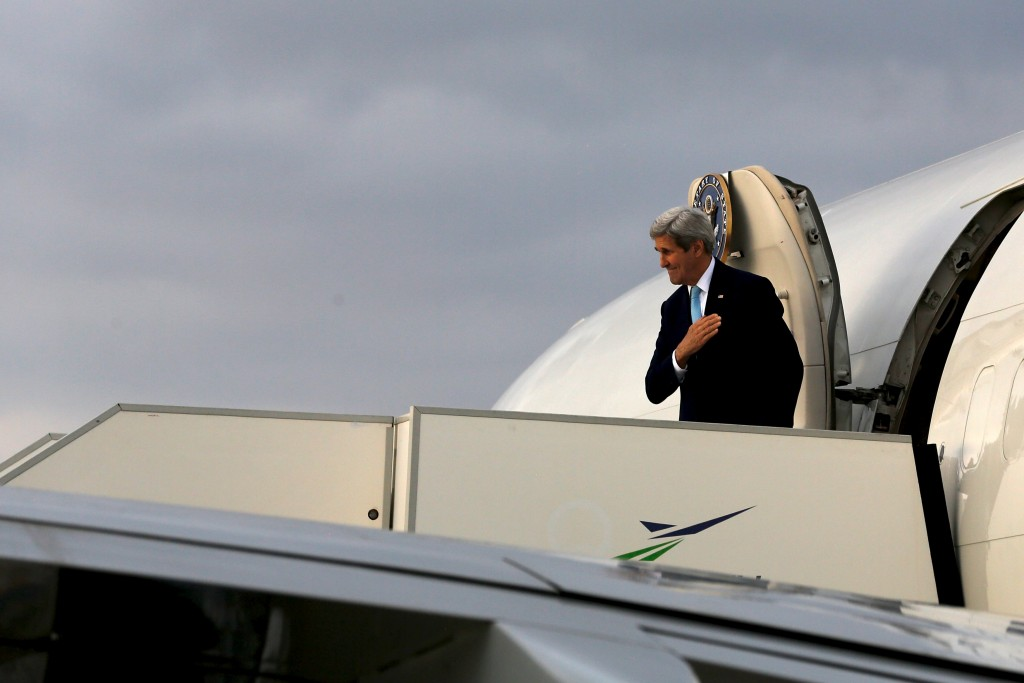 U.S. Secretary of State John Kerry boards his plane to return to Washington from Athens International Airport in Athens, Greece December 4, 2015. REUTERS/Jonathan Ernst
