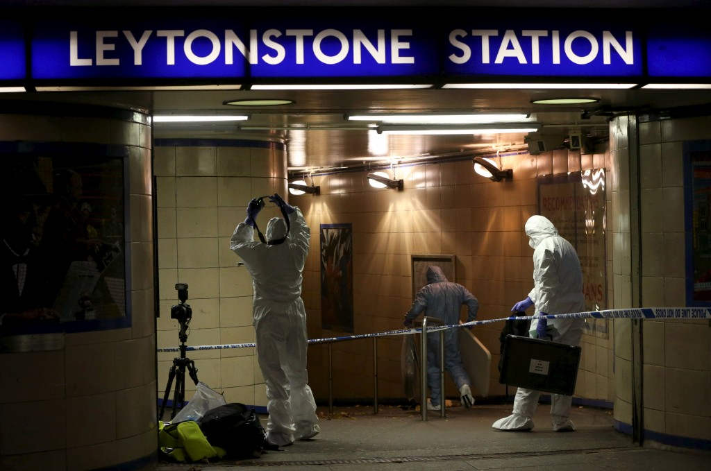 Police officers investigate a crime scene at Leytonstone underground station in east London, Britain (Neil Hall/Reuters)