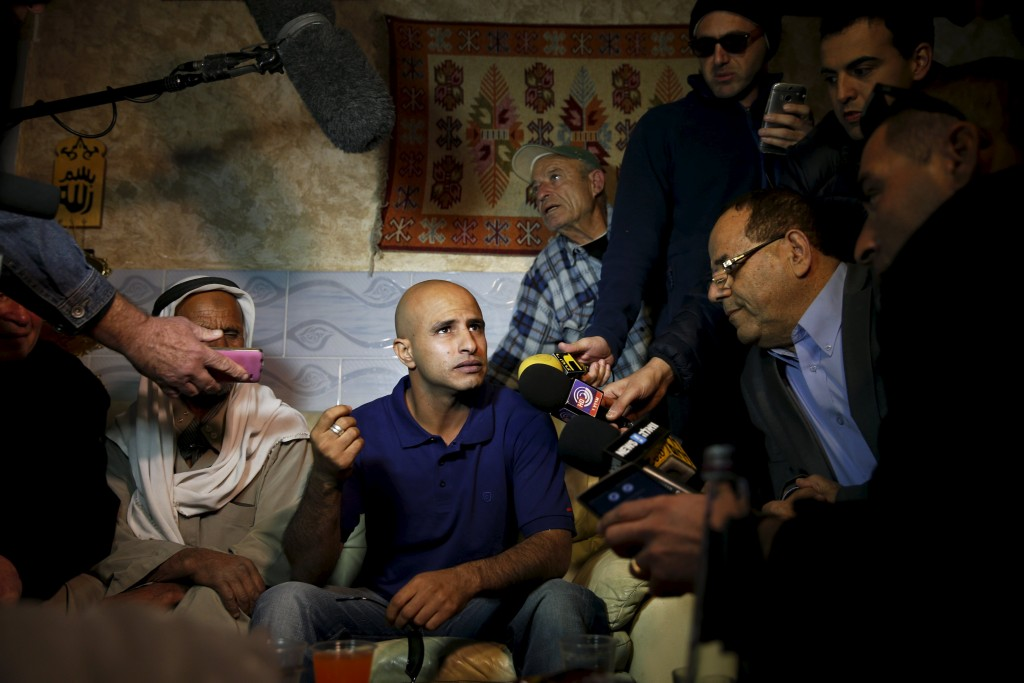 Uda Tarrabin (C) speaks to the media after arriving home following 15 years in Egypt, in the Tarrabin tribe's village near Rahat in southern Israel, December 10, 2015. Egypt has freed Tarrabin, an Israeli-Arab held in its jails for 15 years on espionage charges in exchange for the release of two Egyptians held in Israel, Egyptian and Israeli officials said on Thursday. REUTERS/Amir Cohen TPX IMAGES OF THE DAY
