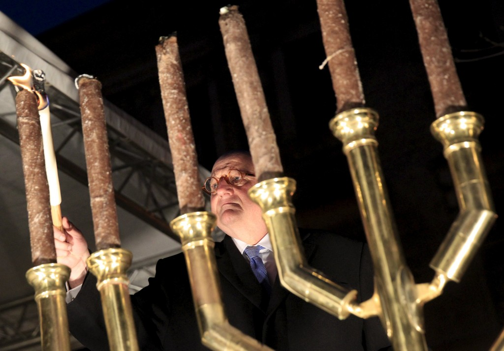 Ira Forman, U.S. Special Envoy of the Office to Monitor and Combat Anti-Semitism, lights a menorah during a protest against a planned statue of Balint Homan in Szekesfehervar, Hungary, on Sunday night. (Reuters/Bernadett Szabo)