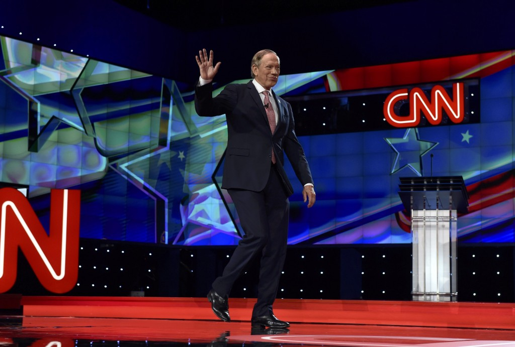 George Pataki arriving onstage to participate in the undercard debate for lower-polling candidates held prior to the Republican presidential debate in Las Vegas on December 15. (Reuters/David Becker)