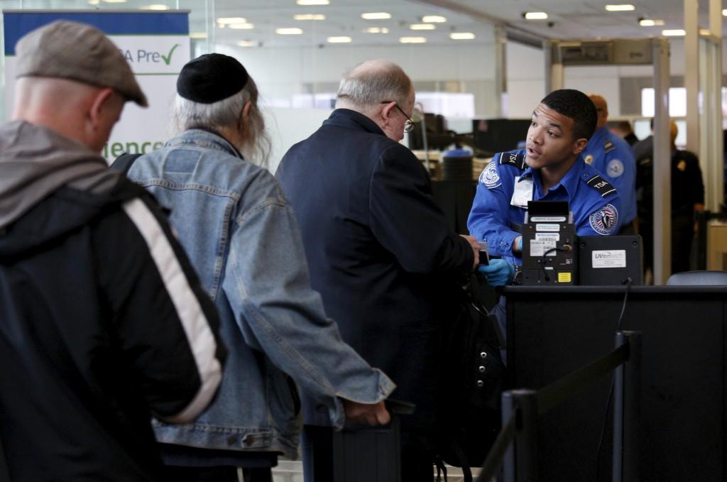 Travelers make their way through a TSA checkpoint at Reagan National Airport in Washington December 23, 2015. (Kevin Lamarque/Reuters)
