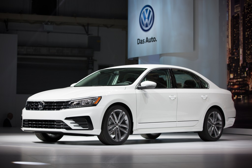 The Volkswagen Passat is displayed during a recent reveal event at the Brooklyn Navy Yard in New York. German automaker reports that November 2015 U.S. sales fell almost 25 percent from a year ago. (AP Photo/Kevin Hagen)