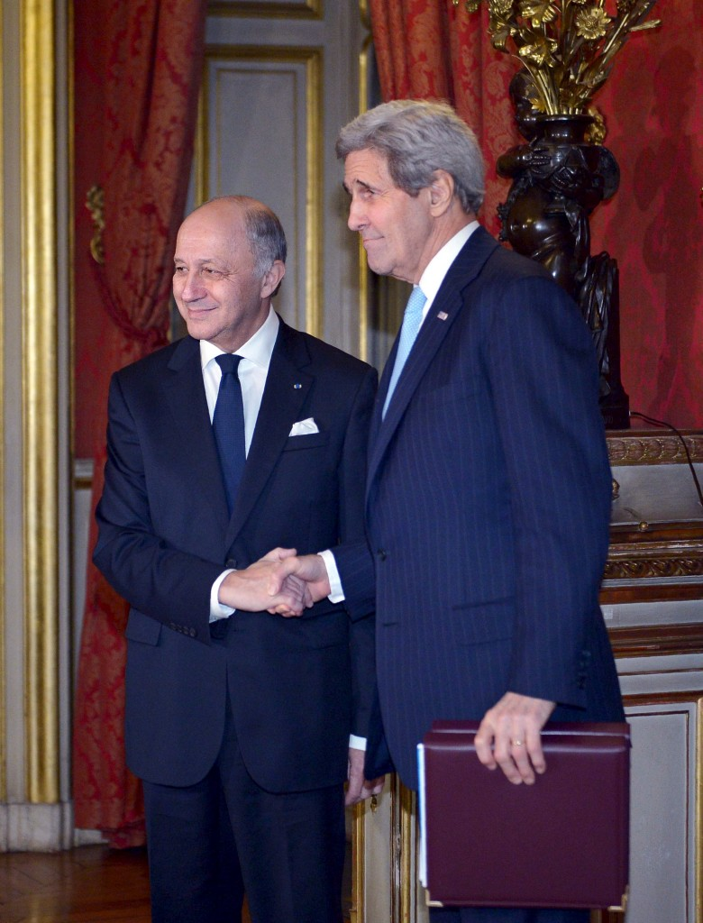 French Foreign Minister Laurent Fabius (L) shakes hands with U.S. Secretary of State John Kerry as he welcomes him to a ministerial meeting on Syria at the Quai d'Orsay, Ministry of Foreign Affairs, in Paris, on Monday. (Reuters/Mandel Ngan/Pool)