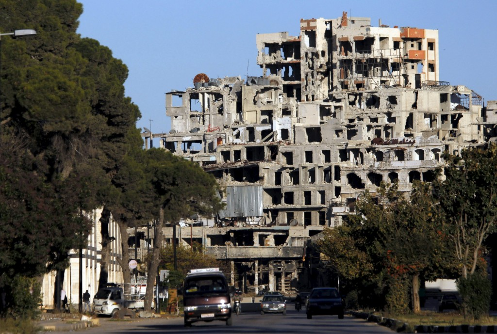 Damaged buildings near the new clock square in the old city of Homs, Syria, on Monday. (Reuters/Omar Sanadiki)
