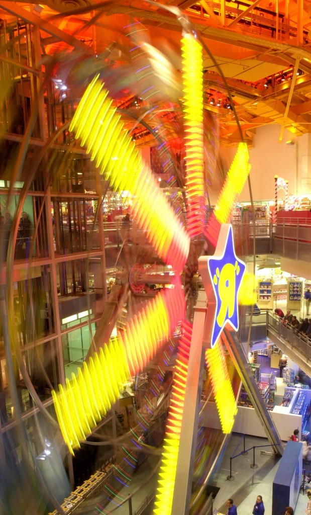 "A 60-foot Ferris wheel, one of the attractions inside the Times Square Toys ""R"" Us store, is shown in this file photo. (AP Photo/Mark Lennihan)"