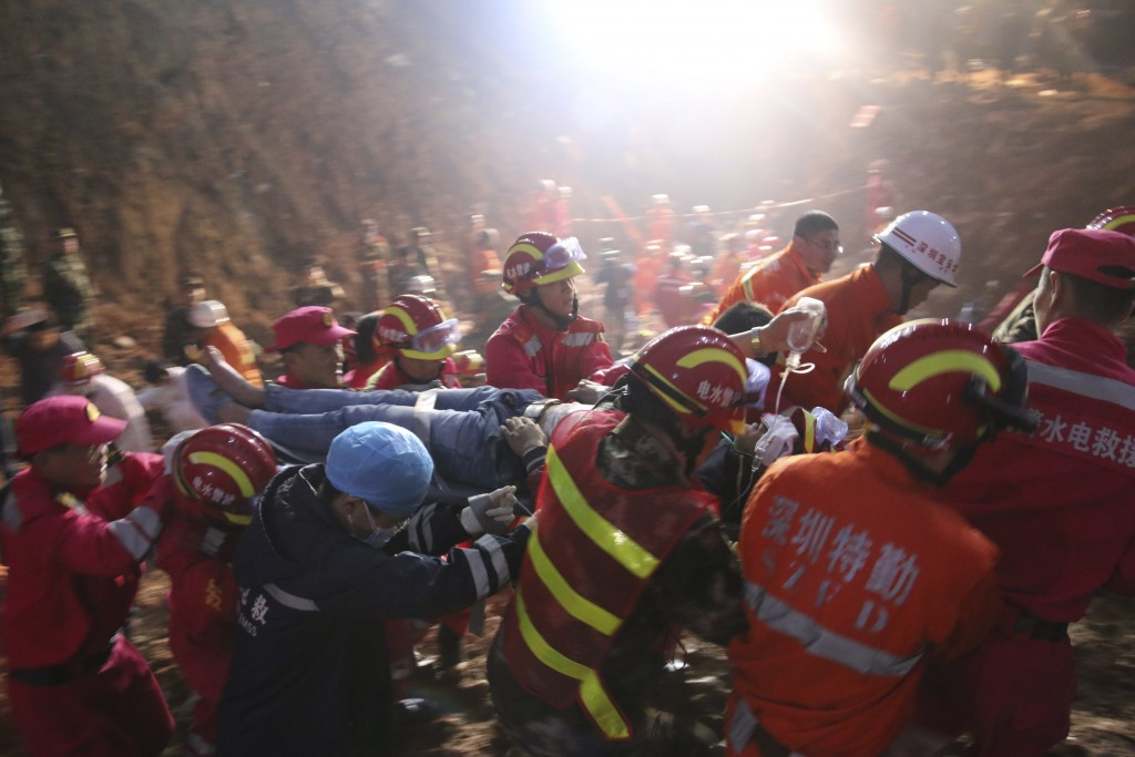 The 19-year-old survivor is carried on a stretcher after being pulled out by rescuers more than 60 hours after a landslide hit an industrial park on Sunday, in Shenzhen, Guangdong province, China, December 23, 2015. REUTERS/China Daily ATTENTION EDITORS - THIS PICTURE WAS PROVIDED BY A THIRD PARTY. THIS PICTURE IS DISTRIBUTED EXACTLY AS RECEIVED BY REUTERS, AS A SERVICE TO CLIENTS. CHINA OUT. NO COMMERCIAL OR EDITORIAL SALES IN CHINA.