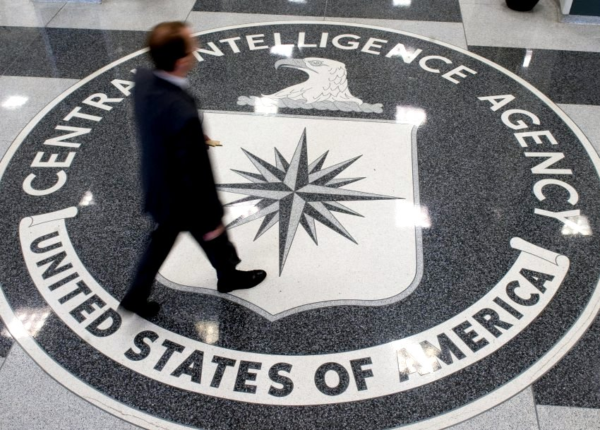 A man walks over the seal of the Central Intelligence Agency (CIA) in the lobby of CIA Headquarters in Langley, Virginia, on August 14, 2008. (Flickr)