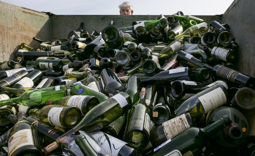 500 bottles of counterfeit and unsellable wine are destroyed at the Texas Disposal Systems recycling and compost facility in Austin, Texas, on Thursday. (Rodolfo Gonzalez/Austin American-Statesman/statesman.com via AP)
