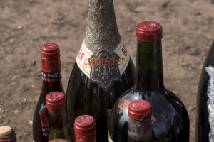 "The word ""counterfeit"" is stamped on a few of the 500 bottles of wine destroyed by the U.S. Marshals Asset Forfeiture Division at the Texas Disposal Systems recycling and compost facility in Austin, Texas, on Thursday. (Rodolfo Gonzalez/Austin American-Statesman/statesman.com via AP)"