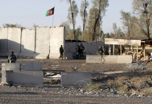 Afghan security forces stand guard at the entrance gate of Kandahar Airport. (REUTERS/Stringer)