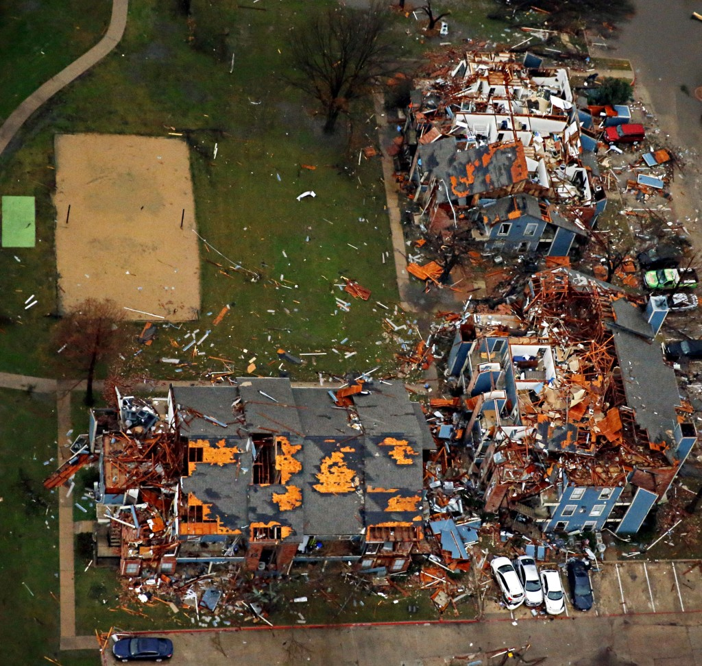 Damage to an apartment complex is seen after Saturday's tornado in Garland, Texas, Sunday, Dec. 27, 2015. At least 11 people died and dozens were injured in apparently strong tornadoes that swept through the Dallas area and caused substantial damage this weekend. (G.J. McCarthy/The Dallas Morning News via AP) MANDATORY CREDIT