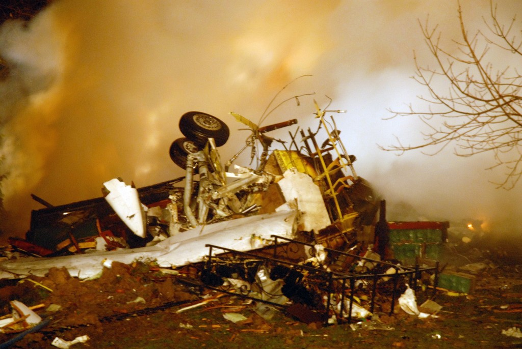 The wreckage of Continental flight 3407 lies amid smoke at the scene after crashing into a suburban Buffalo home and erupting into flames late Thursday Feb. 12, 2009, killing all 48 people aboard and at least one person on the ground, according to authorities. The 74-seat Q400 Bombardier aircraft, operated by Colgan Air, was flying from Newark Liberty International Airport in New Jersey to Buffalo Niagara International Airport. (AP Photo/Dave Sherman)