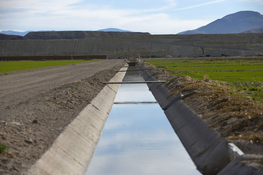 In this 2009 photo, irrigation ditches and crop fields are located right in the center of the uranium plume spreading from the former Anaconda copper mine site near Yearington, Nev. (AP Photo/Scott Sady, file)